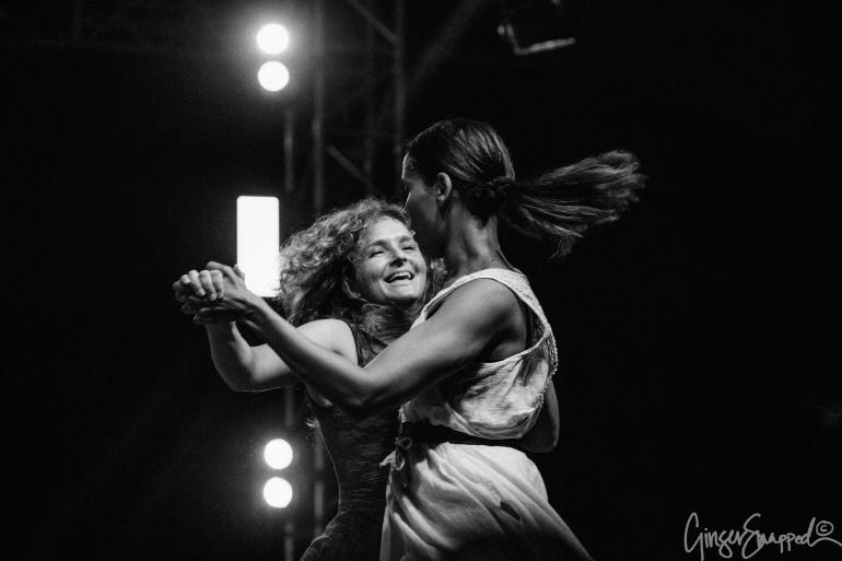 Rhiannon Giddens and Abigail Washburn dance together