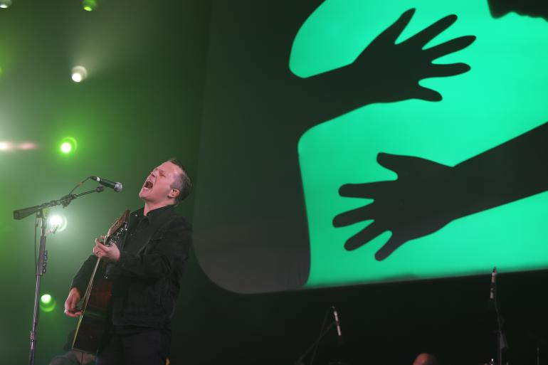 Jason Isbell performing at the UNITE to Face Addiction rally in Washington, D.C.