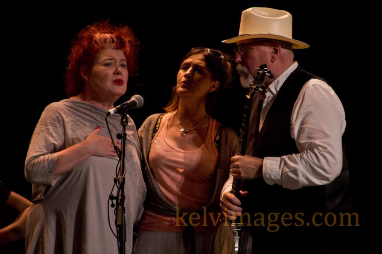 Strong vocal trio of Maura O'Conner, Karen Matheson and Joe Newberry indoors at Merlefest